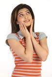 muchacha atractiva con las manos en sus mejillas Foto de archivo