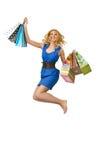 Muchacha atractiva con los bolsos Imágenes de archivo libres de regalías