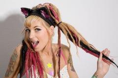 Muchacha atractiva con los tatuajes Fotografía de archivo libre de regalías