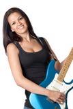 Muchacha atractiva con una guitarra eléctrica azul Foto de archivo libre de regalías