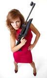 Muchacha atractiva de la acción con el arma Fotografía de archivo libre de regalías