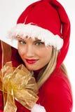 Muchacha atractiva de Santa con el presente Foto de archivo
