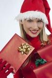 Muchacha atractiva de Santa con los presentes Imagen de archivo libre de regalías