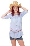 Muchacha atractiva del redhead con el sombrero de paja, aislado Foto de archivo