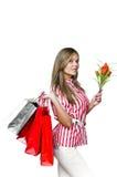Muchacha atractiva después de hacer compras Fotografía de archivo libre de regalías