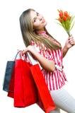 Muchacha atractiva después de hacer compras Imágenes de archivo libres de regalías