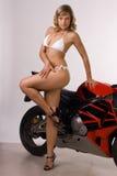 Muchacha atractiva en la moto Fotos de archivo