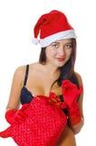 Muchacha atractiva en ropa interior negra y un sombrero de la Navidad Fotografía de archivo