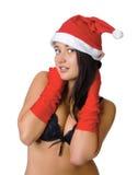 Muchacha atractiva en ropa interior negra y un sombrero de la Navidad Fotos de archivo