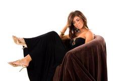 Muchacha atractiva en silla Imagen de archivo libre de regalías