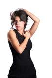 Muchacha atractiva en vestido negro Foto de archivo libre de regalías