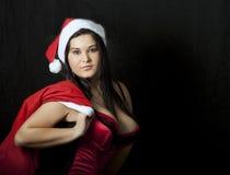 Muchacha atractiva joven en el traje de Papá Noel Fotografía de archivo