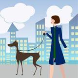 Muchacha atractiva que camina con un perro stock de ilustración