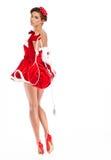 muchacha atractiva que lleva la ropa de Papá Noel Fotos de archivo libres de regalías
