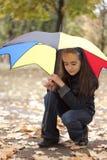 Muchacha bajo el paraguas Imagen de archivo