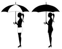 Muchacha bajo el paraguas Fotografía de archivo libre de regalías