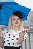 Muchacha bajo la lluvia Fotografía de archivo