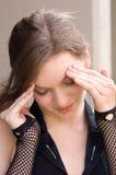 Muchacha bastante adolescente con dolor de cabeza Foto de archivo