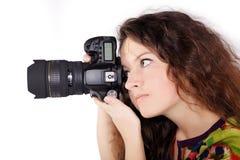 Muchacha bastante adolescente con la cámara aislada Fotos de archivo