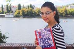 Muchacha bastante adolescente con los vidrios Imágenes de archivo libres de regalías