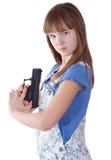 Muchacha bastante adolescente con un arma Foto de archivo libre de regalías