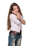 Muchacha bastante adolescente con un teléfono celular Fotografía de archivo