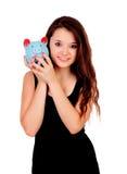 Muchacha bastante adolescente con una hucha azul Imagen de archivo