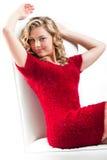 Muchacha bastante adolescente en un vestido rojo Imagenes de archivo