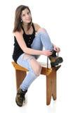 Muchacha bastante adolescente que pone botas del trabajo Imagen de archivo libre de regalías
