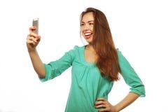 Muchacha bastante adolescente que toma selfies Imagenes de archivo