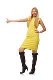Muchacha bastante justa en el vestido amarillo aislado en blanco Imagenes de archivo