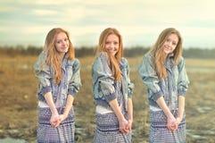 Muchacha bastante pelirroja en la imagen de hermanas gemelas Fotografía de archivo