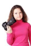 Muchacha bastante rizada con la cámara aislada Fotos de archivo libres de regalías