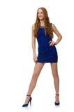 Muchacha bastante roja del pelo en el vestido azul aislado en Imagen de archivo