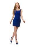 Muchacha bastante roja del pelo en el vestido azul aislado en Fotografía de archivo