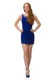 Muchacha bastante roja del pelo en el vestido azul aislado encendido Imágenes de archivo libres de regalías