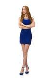 Muchacha bastante roja del pelo en el vestido azul aislado encendido Fotografía de archivo