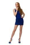 Muchacha bastante roja del pelo en el vestido azul aislado encendido Foto de archivo