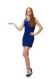 Muchacha bastante roja del pelo en el vestido azul aislado encendido Fotos de archivo libres de regalías
