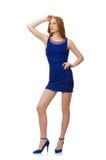 Muchacha bastante roja del pelo en el vestido azul aislado encendido Imagen de archivo libre de regalías