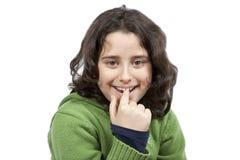 Muchacha bastante tímida que muerde su dedo Imagen de archivo
