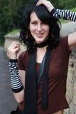 Muchacha black-haired sonriente Foto de archivo libre de regalías