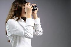 Muchacha blanca que crea las fotos Imágenes de archivo libres de regalías