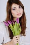 Muchacha blanda con los tulipanes Imagen de archivo libre de regalías