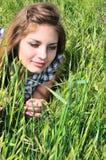 Muchacha blanda dulce en hierba Imágenes de archivo libres de regalías