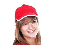 Muchacha bonita con el casquillo rojo Foto de archivo libre de regalías