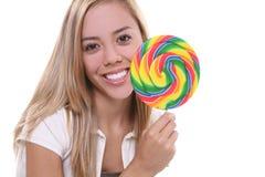 Muchacha bonita con el Lollipop Imagenes de archivo
