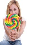 Muchacha bonita con el Lollipop Imagen de archivo