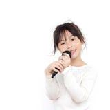 Muchacha bonita con el micrófono Foto de archivo