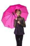 Muchacha bonita con el paraguas rosado. Aislado Fotografía de archivo libre de regalías